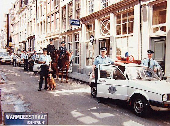 Police agents in Amsterdam's Red Light District. This picture was shot in the 80's on the Warmoesstraat in Amsterdam.