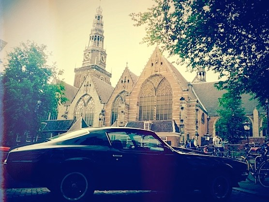 An awesome car standing in front of The Old Church in Amsterdam's Red Light District.