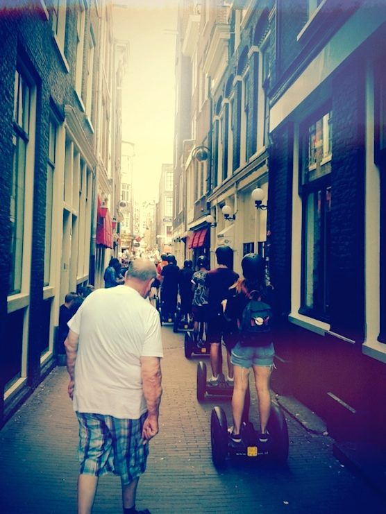 People are getting a Segway tour in Amsterdam's Red Light District