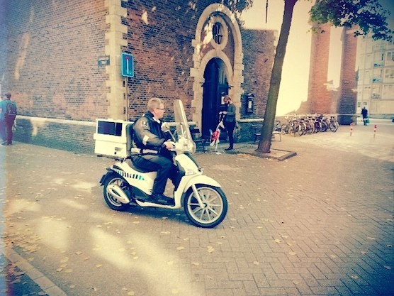 A scooter in front of The Zuiderkerk Church in Amsterdam