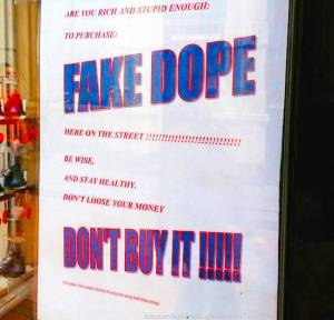 fake drug dealers in Amsterdam. Sign from local