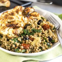 Mediterranean couscous with roasted cauliflower steaks
