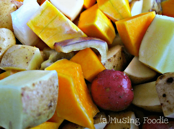 Roasted potatoes, butternut squash, peppers and onions