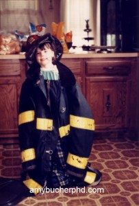 Me at age 4 in my dad's firefighting gear. No one tells you how heavy and stinky those coats are!