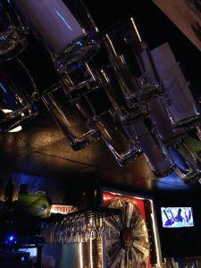 Mugs on display above the bar