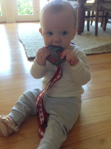 You're never too young to appreciate a good race medal, right, P?
