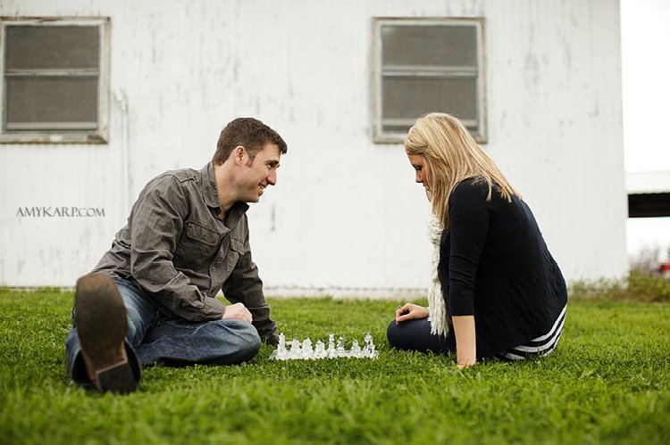 olivia and bobby's farm engagement session with a horse and chess set in ennis texas by dallas wedding photographer amy karp (9)
