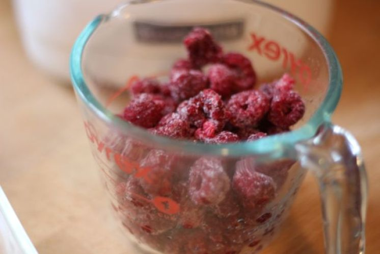 measuring cup of raspberries