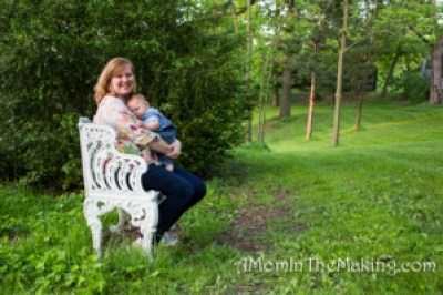 Woman and baby on park bench