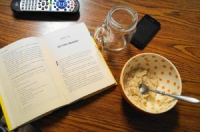 Bowl of oatmeal by a book