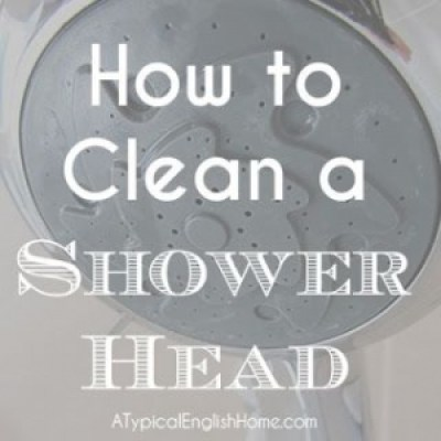 Cleaning a shower head.