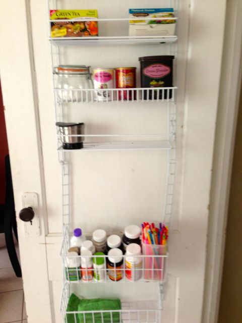 Door to kitchen containing a hanging shelf