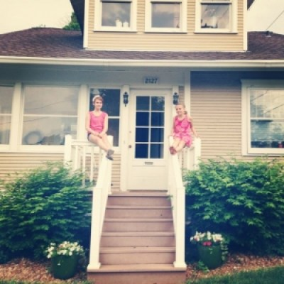 Girls watching thunderstorm on house.