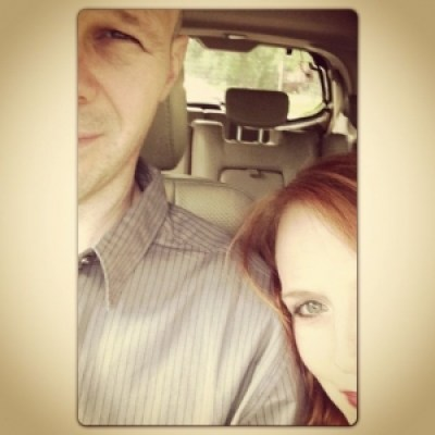 Husband and wife driving to Omaha in a car.