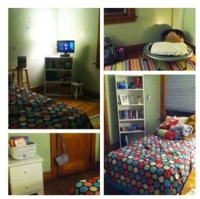 a clean girls bedroom with polkadot bedspread