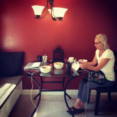 grandma at kitchen table with computer
