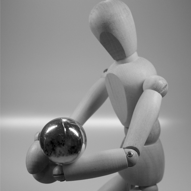 wooden figure with a volleyball