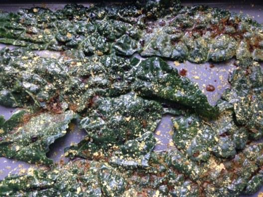 Nutritional yeast on kale leaves.