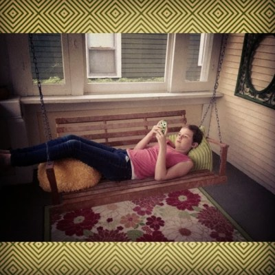 daughter relaxing in the sunroom on porch swing