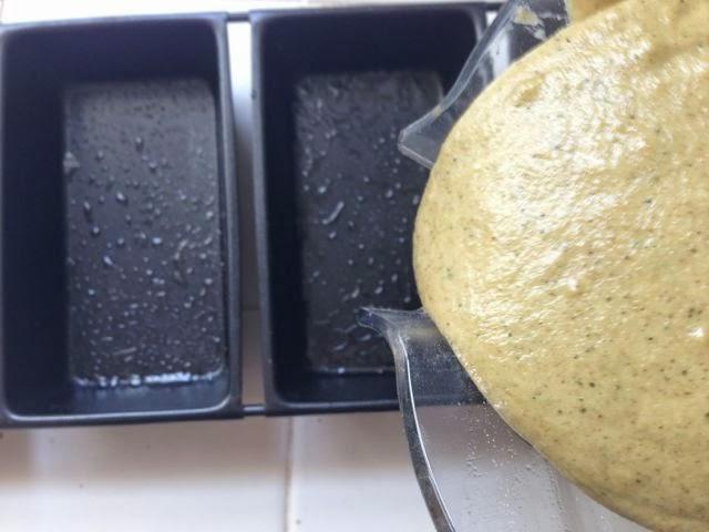 pouring zucchini bread batter into a bread pan