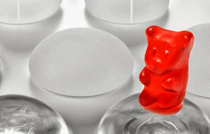 gummy bear sitting on top of a breast implant