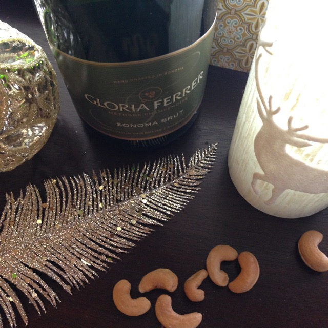 Glittery feather, reindeer candle and wine for a gift basket