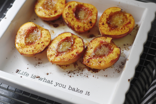 White baking dish of baked peaches