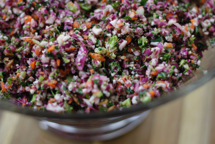 finely chopped vegetables in a glass bowl