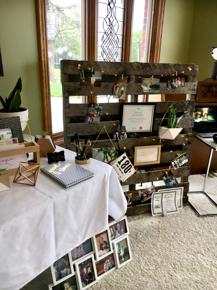 pallet with pictures hanging on it for a graduation open house