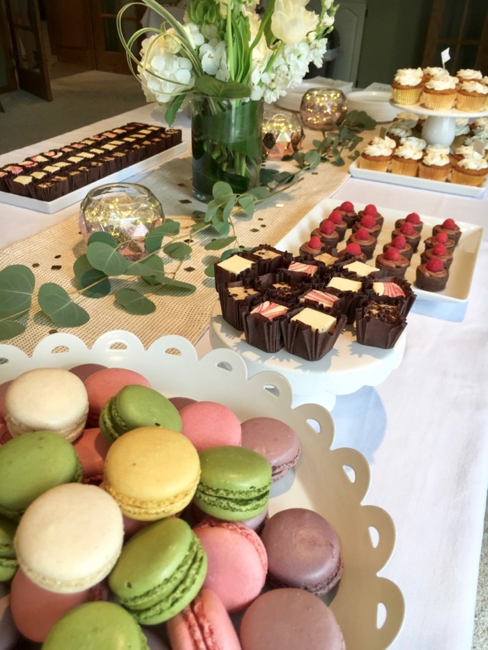 macarons and desserts on a decorated table