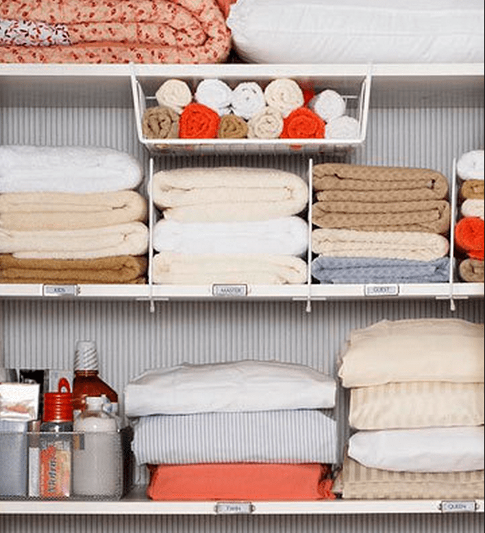 stacks of linens organized on shelves in closet