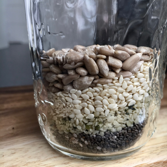 layered Mixed seeds in a mason jar