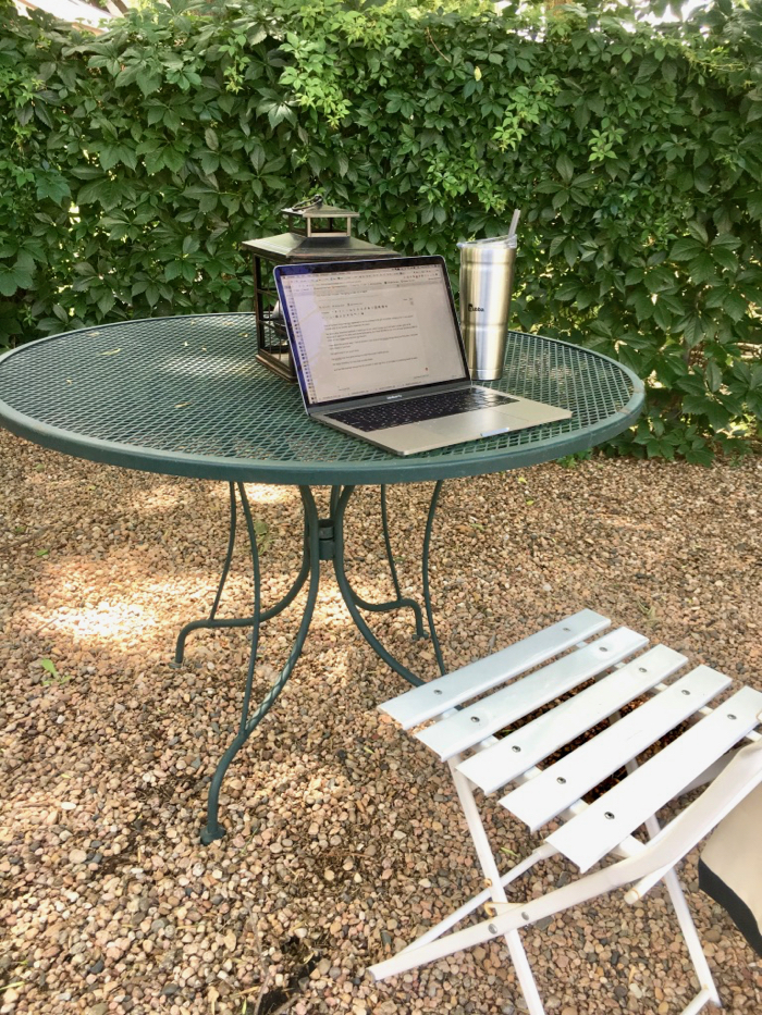 computer on table working outdoors