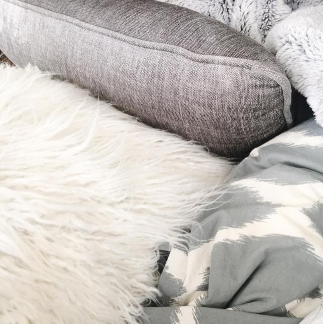 white fuzzy pillow