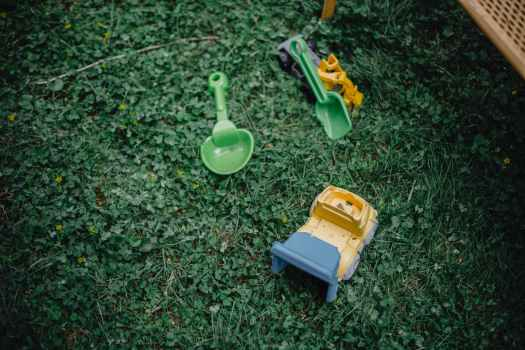 colourful plastic toys in garden