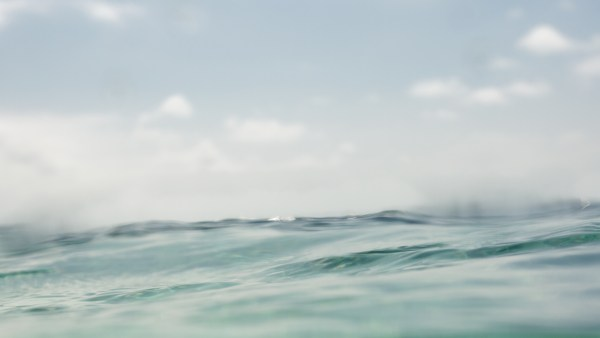 ARTISTIC IMAGE OF THE SKY FROM THE WATER LEVEL OF THE SEA