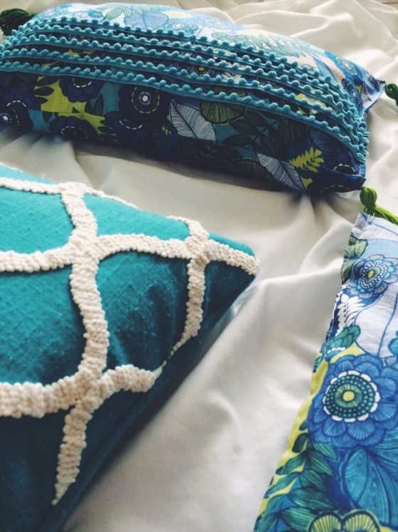 Create a simple DIY pillow and add embellishment with your glue gun! No sew pillow details on the blog with this anthropologie inspired DIY pillow tutorial.