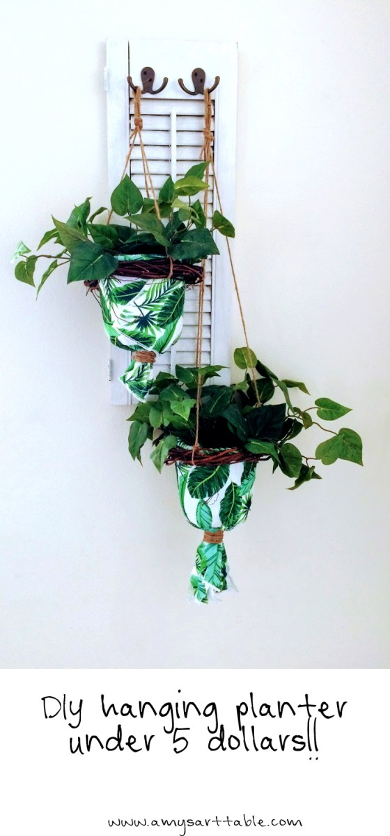Make a DIY hanging planter for under five dollars!! This was so easy and only took me about 30 minutes. Tutorial available at www.amysarttable.com