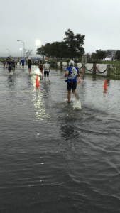 That's my friend Darrell running through the water at Ironman Maryland. They ran through these flooded sections over and over. That's definitely unexpected.
