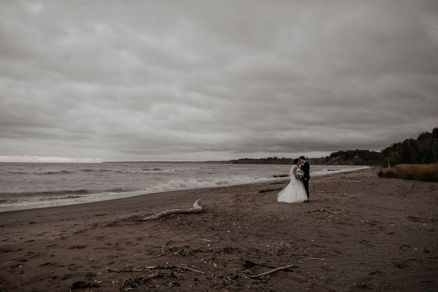 Stormy beach wedding portrait