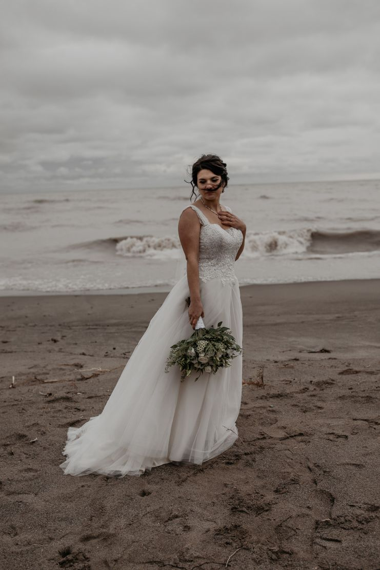Bridal portrait on a stormy beach