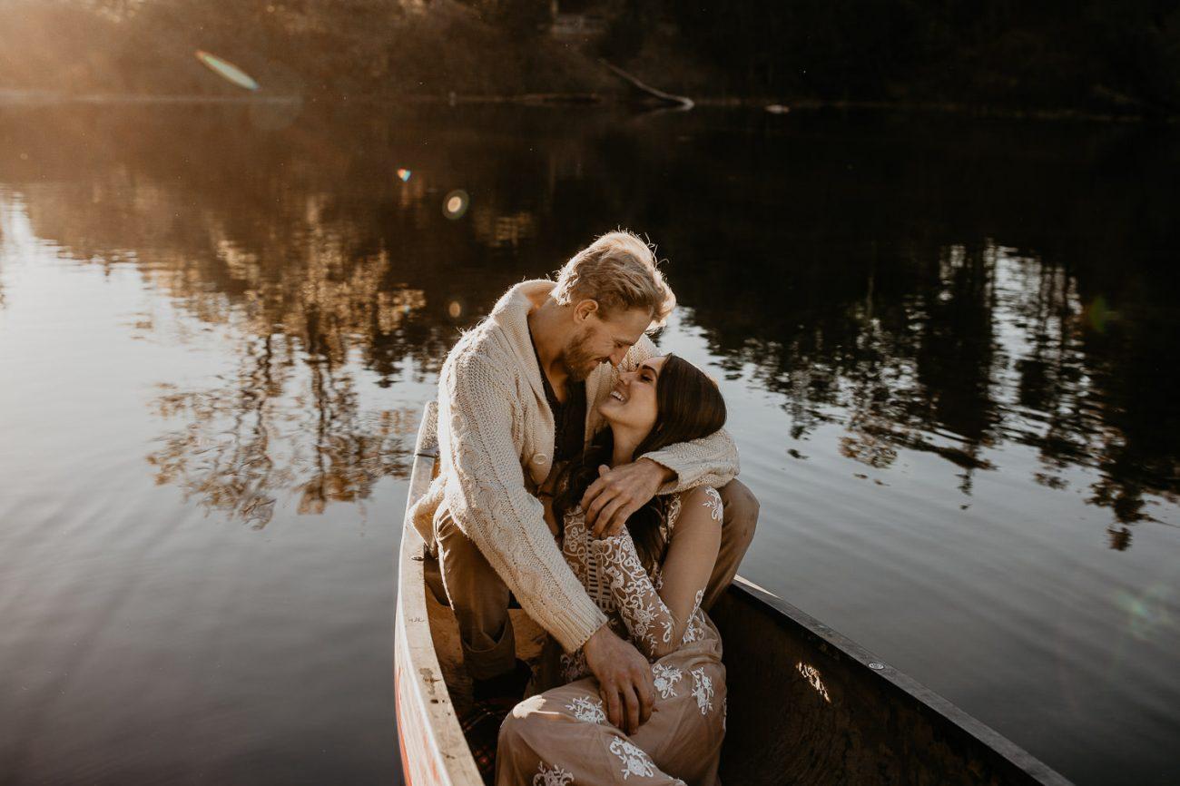 Couple cuddling in a canoe