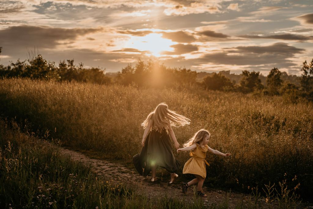 little girls twirling in the sunlight