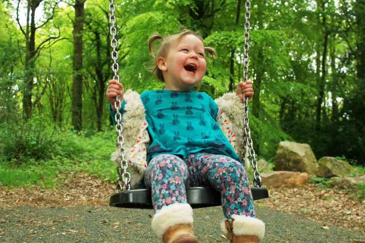 Little Rose playing on a swing