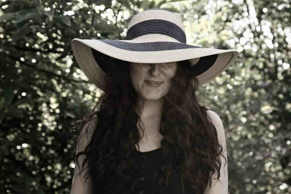 Black and white image of Joules navy and natural striped floppy hat