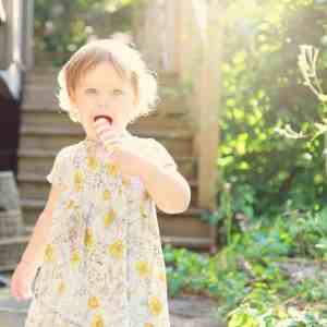 Toddler eating ice cream in the sunshine