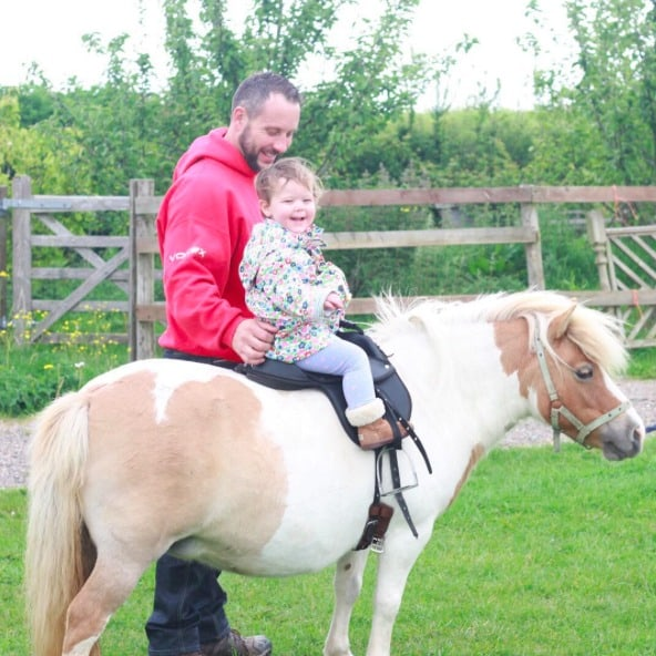 Little girl riding a shetland pony