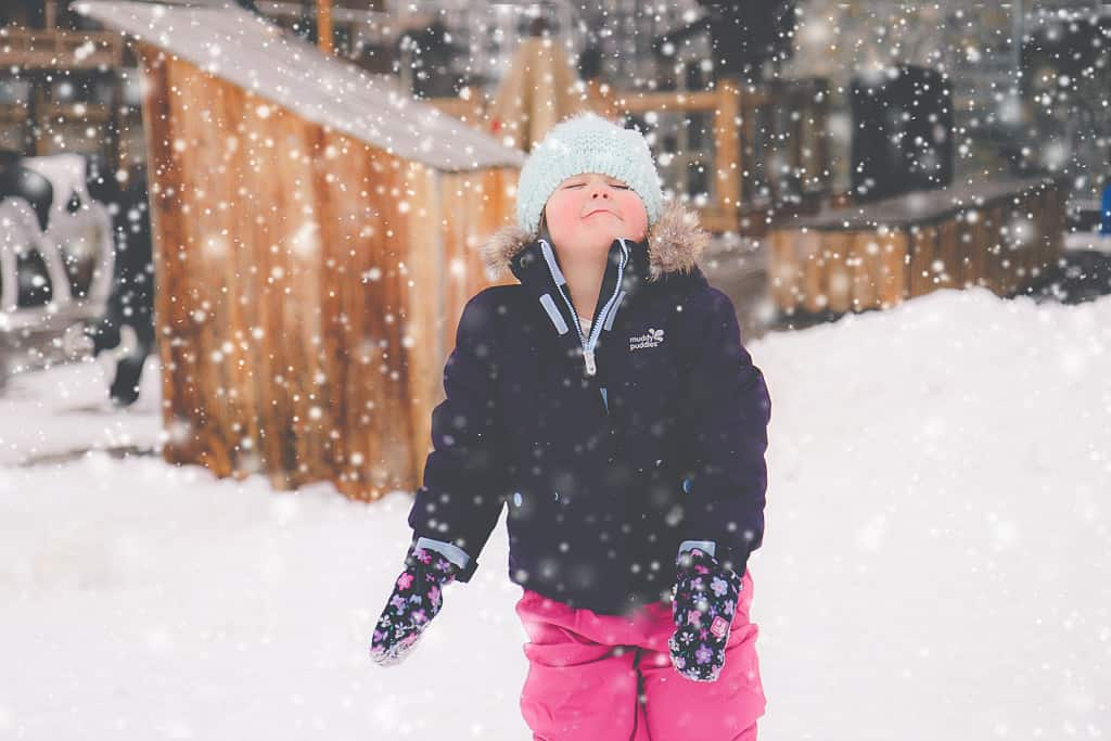 Little girl seeing snow for the first time