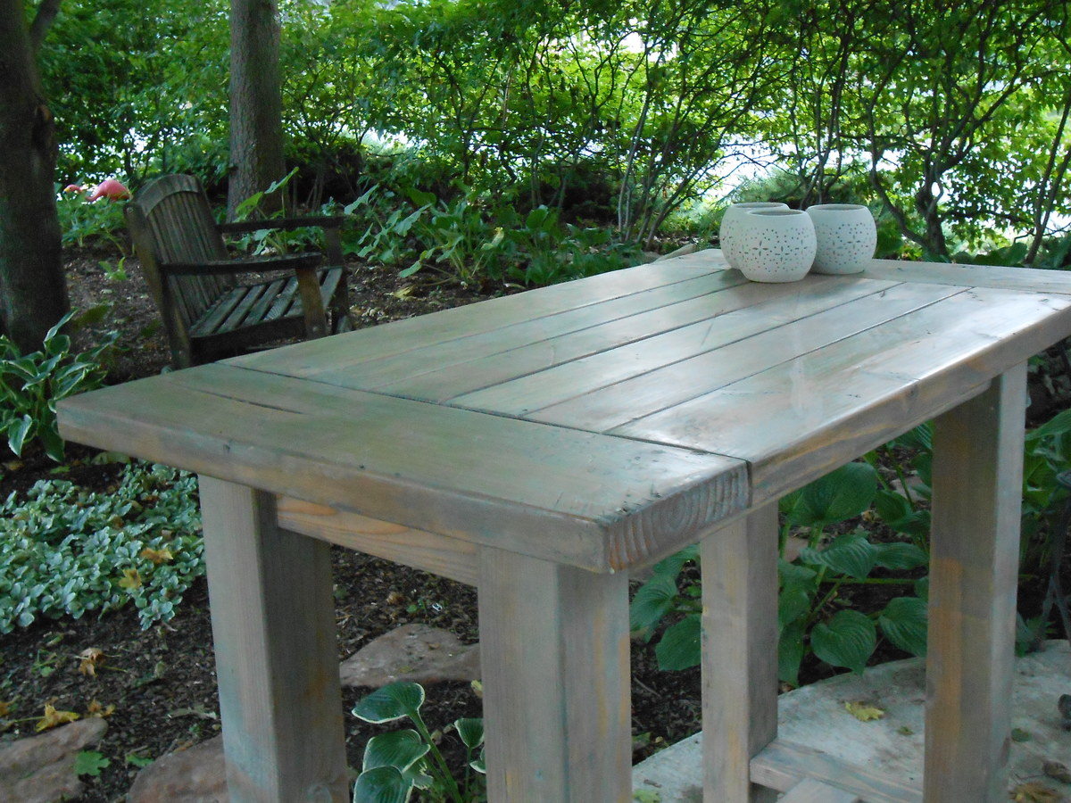 Ana White  Farmhouse table modified to become an outdoor