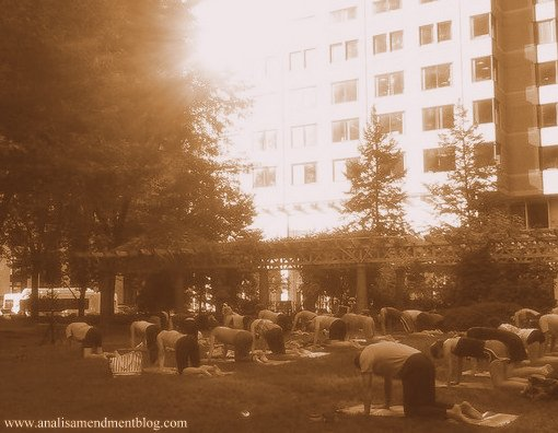 A sepia image showing one of many free yoga classes in Boston.